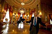 Newport RI, USA - A tour guide explains the details of the music room in the Breakers, the incredibly ornate 19th century Vanderbilt mansion of the guilded era in Newport.