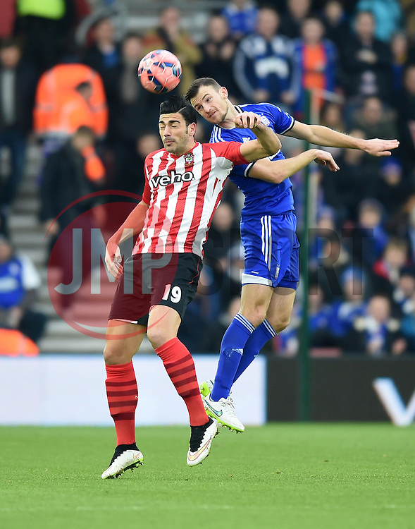 Ipswich Town's Darren Ambrose heads the ball over Southampton's Graziano Pelle - Photo mandatory by-line: Paul Knight/JMP - Mobile: 07966 386802 - 04/01/2015 - SPORT - Football - Southampton - St Mary's Stadium - Southampton v Ipswich Town - FA Cup Third Round