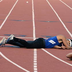 Athletes fall during the 400 meter JV dash during the Del Rio League Track and Field Championship at La Mirada High School in La Mirada, Calif., Thursday, May 7, 2015.