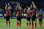 Bournemouth players clap the away fans during the Sky Bet Championship match between Sheffield Wednesday and Bournemouth at Hillsborough, Sheffield, England on 4 November 2014.