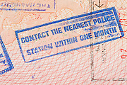 Passport page with Jordan immigration control stamp instructing to contact the nearest police station within one month.