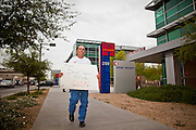 06 APRIL 2011 - PHOENIX, AZ: Dan Pollard (CQ) a retiree from Peoria who receives Social Security, pickets the Social Security offices on N 7th Ave in Phoenix Wednesday. A handful of people attended the picket, which was organized by Strengthen Social Security, Alliance for Retired Americans and AFGE (American Federation of Government Employees). The picket was held to draw attention to the importance of Social Security in advance of an expected government shutdown later this week. Similar events were held across the country.   PHOTO BY JACK KURTZ