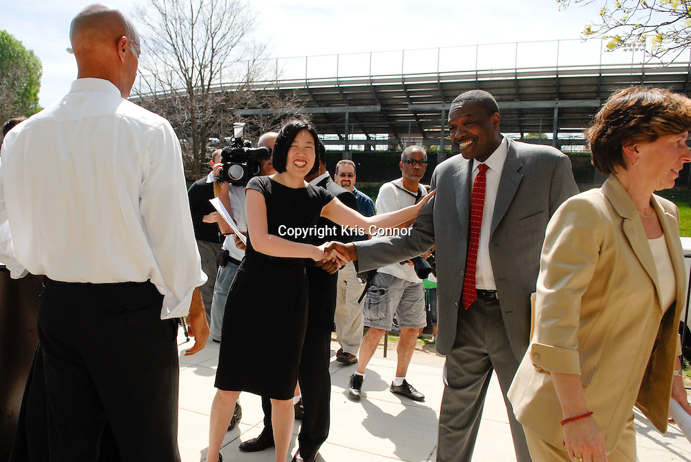 (L-R) Michelle Rhee, Chancellor of DC Public Schools, George Parker, President of the Washington Teachers' Union, shake hands during a press conference on the tentative agreement on the new contract between the Washington Teachers Union and District of Columbia Public Schools on the steps of Eliot Junior High School in Northeast Washington DC on April 7th, 2010