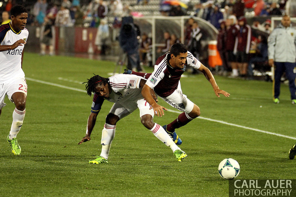 August 3rd, 2013 - Colorado Rapids midfielder Tony Cascio (14) takes a hard tackle from Real Salt Lake midfielder Lovel Palmer (7) in second half action of the Major League Soccer match between Real Salt Lake and the Colorado Rapids at Dick's Sporting Goods Park in Commerce City, CO