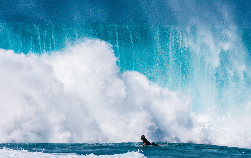 A surfer caught inside of a big breaking wave at the Banzai Pipeline, North Shore, Oahu, Hawaii