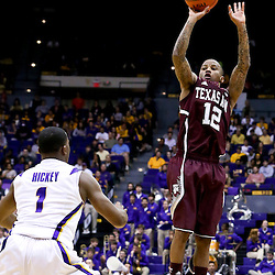 Jan 23, 2013; Baton Rouge, LA, USA; Texas A&M Aggies guard Fabyon Harris (12) shoots over LSU Tigers guard Anthony Hickey (1) during the first half of a game at the Pete Maravich Assembly Center. Mandatory Credit: Derick E. Hingle-USA TODAY Sports