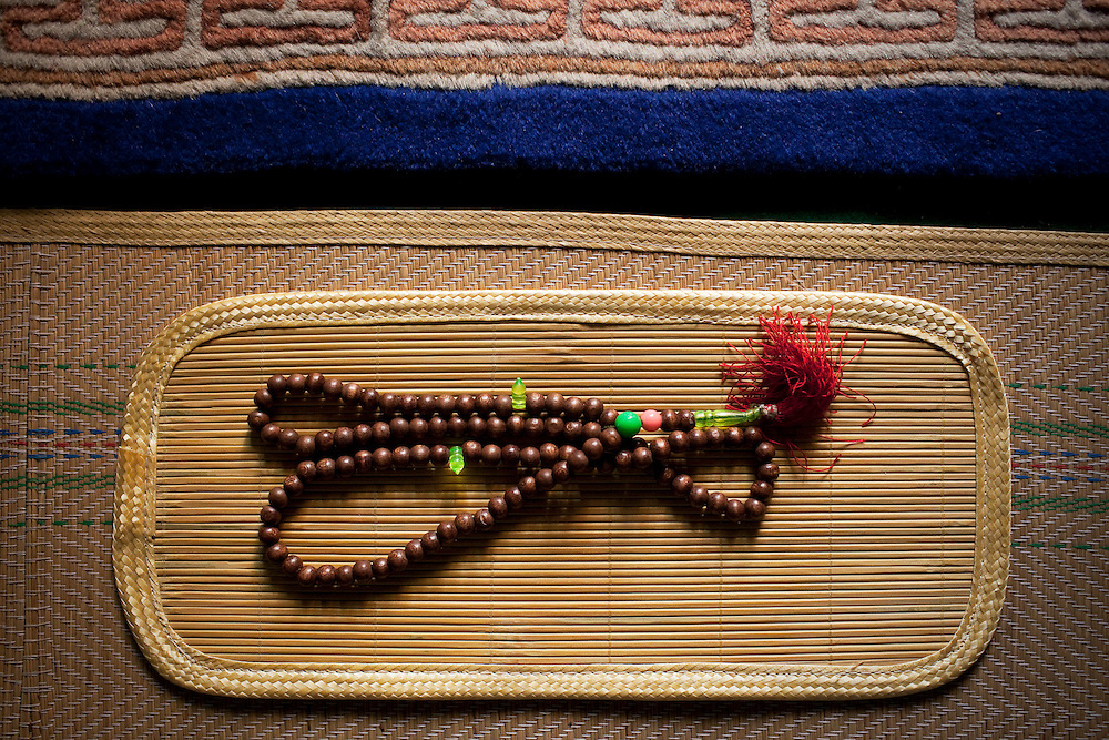 Prayer beads on a mat in the Wangjia women's mosque in Kaifeng, China. The mosques began as Quranic schools for girls in the late 17th century. They were the only places girls could receive an education; now, they also serve as community centers.