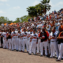 March 24, 2012; Sarasota, FL, USA; Baltimore Orioles players stand outside the dugout during the national anthem before a spring training game against the Washington Nationals at Ed Smith Stadium.  Mandatory Credit: Derick E. Hingle-US PRESSWIRE