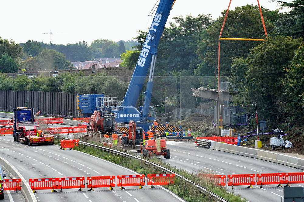 © Licensed to London News Pictures. 16/09/2018<br /> AYLESFORD, UK.<br /> The M20 in Kent remains closed this morning between J4-J6 while work to dismantle and remove Teapot Lane footbridge at Aylesford continues. Diversions are in place as the motorway looks deserted.<br /> The works are part of the project to turn the stretch of the M20 into a smart motorway.<br /> Photo credit: Grant Falvey/LNP