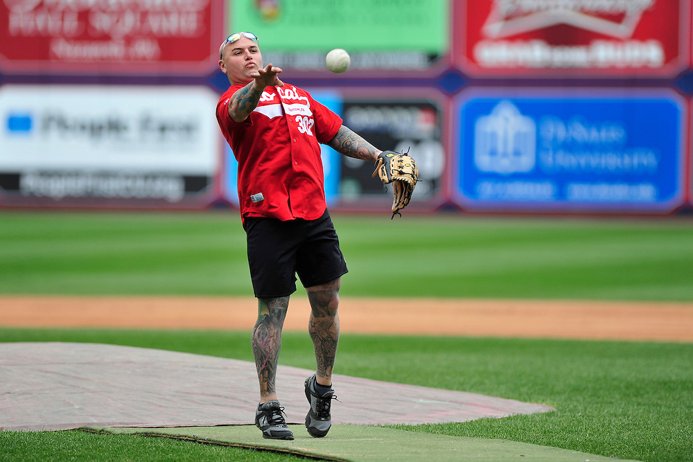 4/26/2014 Allentown, PA Firefighter Chad Long throws the ball. Police Officers and Firefighters from the City of Allentown take to the field at Coca-Cola Park Saturday afternoon for a 90-minute softball game as part of Hero's Night, an IronPigs special event to promote local emergency responders. Express-Times Photo | CHRIS POST
