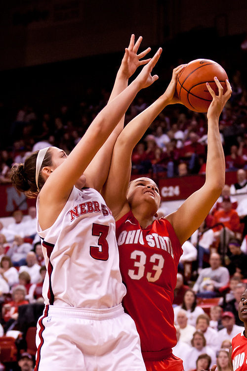 26 February 2012: Ashley Adams #33 of the Ohio State Buckeyes beats out Hailie Sample #3 of the Nebraska Cornhuskers for the rebound at the Devaney Sports Center in Lincoln, Nebraska. Nebraska upset Ohio State 71 to 57.