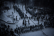 Riot police line up during face off with anti government protesters manning barricades on  Hrushevskoho street in Kiev, 21 January 2014.