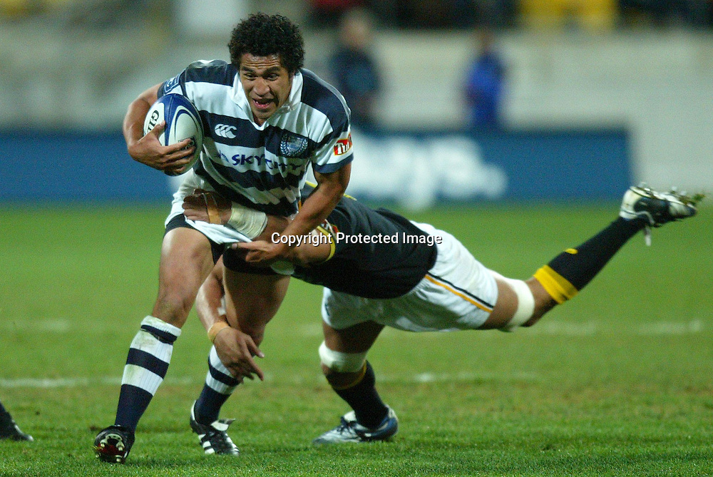Auckland's Mils Muliaina gets tackled by Lion's Jerry Collins during the Wellington Lions 27-21 win over Auckland on Saturday night at the Westpac Stadium, Wellington, New Zealand. NPC Div 1 <br /> 11 September 2004<br /> Photo: Marty Melville/Photosport