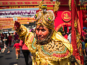 """08 FEBRUARY 2016 - BANGKOK, THAILAND: A man celebrates Chinese New Year in Bangkok's Chinatown district, during the celebration of the Lunar New Year. Chinese New Year is also called Lunar New Year or Tet (in Vietnamese communities). This year is the """"Year of the Monkey."""" Thailand has the largest overseas Chinese population in the world; about 14 percent of Thais are of Chinese ancestry and some Chinese holidays, especially Chinese New Year, are widely celebrated in Thailand.       PHOTO BY JACK KURTZ"""