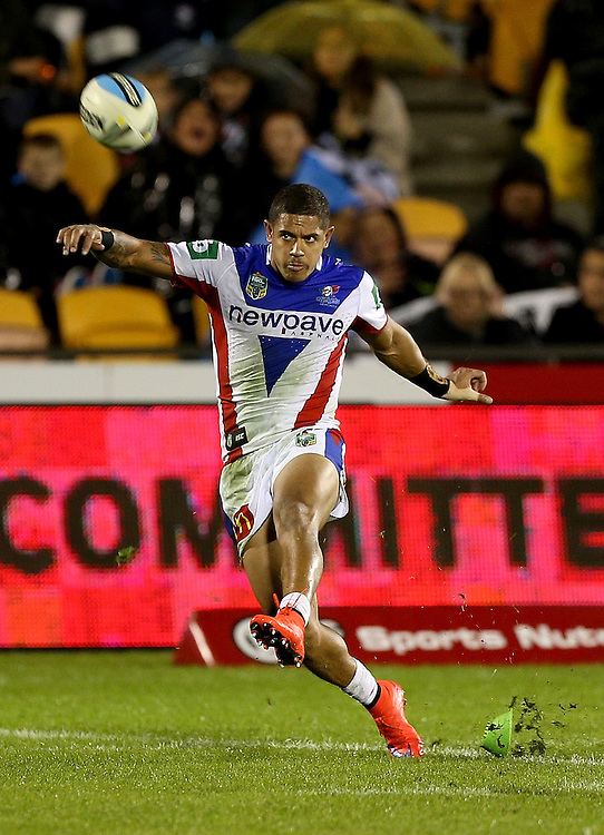 Akuila Uate of the Newcastle Knights takes a conversion kick against the New Zealand Warriors during their round 12 NRL match at Mount Smart Stadium, Auckland on  Sunday, May 31, 2015. Credit: SNPA / David Rowland