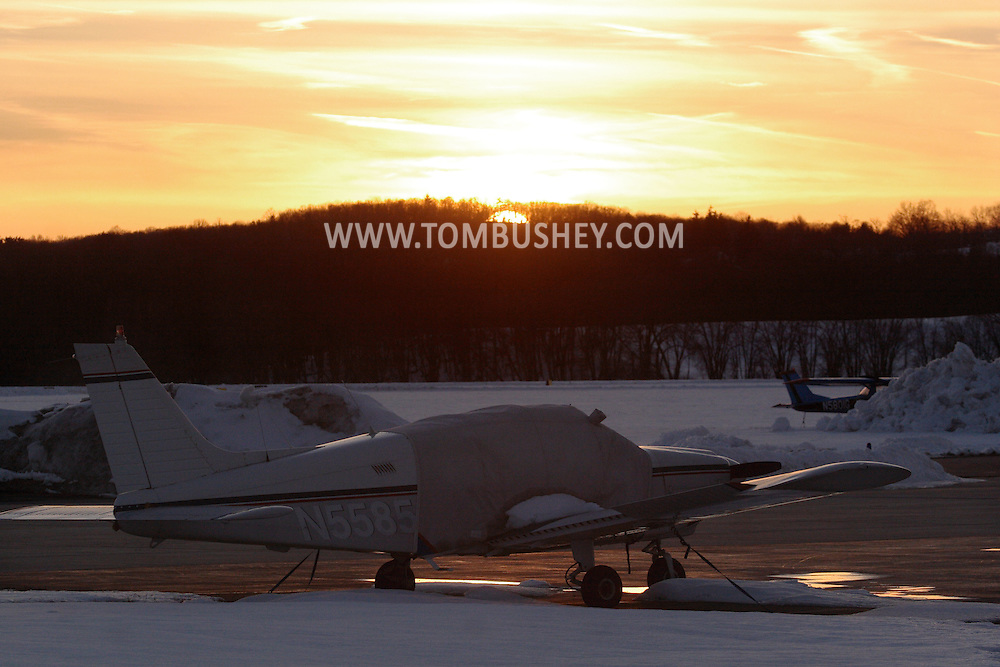 Montgomery, NY - Planes on the tarmac at sunset at Orange County Airport in Montgomery on March 2, 2008.
