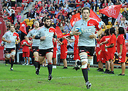 Richie McCaw leads the Crusaders onto Suncorp Stadium ~ Super 15 rugby (Round 15) - Reds v Crusaders played at Suncorp Stadium, Brisbane, Australia on Sunday 29th May 2011 ~ Photo : Steven Hight (AURA Images) / Photosport