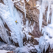 Elijah Weber ice climbing a route called Le Pissoir which is rated WI-5 at The Ouray Ice Park in the Uncompahgre River Gorge near the town of Ouray in southwestern Colorado