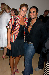 Fashion designer JULIEN MACDONALD and FRANCESCA VERSACE at the launch of 'Blow Lips' a new lipstick by Isabella Blow and MAC Makeup held at the the Blow de la Barra Gallery, 35 Heddon Street, London on 7th September 2005.<br /><br />NON EXCLUSIVE - WORLD RIGHTS