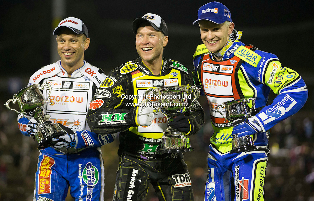 Second place getter Nicki Pederson (Denmark), left, Winner, Martin Smolinski (Germany),middle and third place getter Krzysztof Kasprzak (Poland), right, celebrate on the podium after the final of  the 2014 New Zealand FIM Speedway Grand Prix held at Western Springs, Auckland, New Zealand on Saturday 5th April 2014<br /> Credit; Peter Meecham/ www.photosport.co.nz