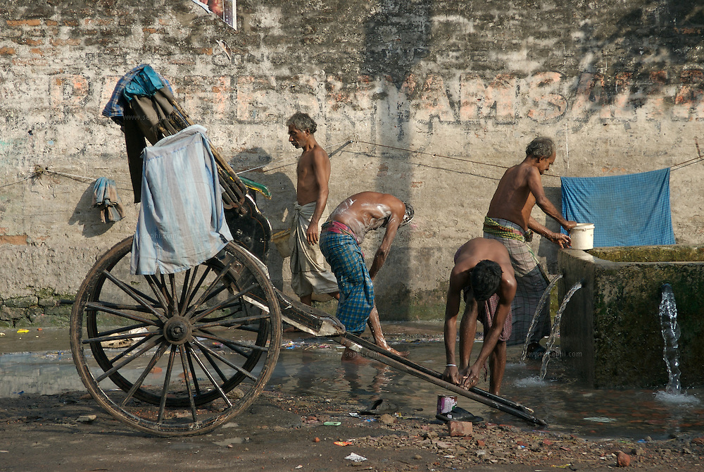 "Rickshaw pullers taking a bath on the streets of Kolkata...The hand-pulled rickshaw of Calcutta, immortalised by Dominic Lapierre's famous novel, City of Joy, will soon be a part of the history books as a bill passed by the West Bengal state assembly described the centuries-old mode of transport as ""inhumane."".The future of about 18,000 rickshaw pullers in the city, earning an avarage daily wages of about 100 rupees ($2.5).is unclear as they call for a compensation package to help them rehabilitate into alternative jobs."