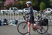 Anna Moore, an Ohio University senior, walks her bike back to its correct location before changing her shoes and completing the rest of the Race for a Reason triathlon, Saturday, April 27, 2013. Race for a Reason, Race 4 A Reason, Annual Events, Events, Students, Faculty & Staff