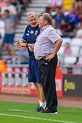 AFC Wimbledon assistant manager Glyn Hodges discusses tactics with AFC Wimbledon manager Wally Downes during the EFL Sky Bet League 1 match between Sunderland and AFC Wimbledon at the Stadium Of Light, Sunderland, England on 24 August 2019.
