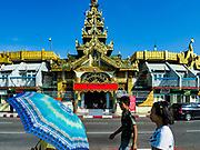 18 NOVEMBER 2017 - YANGON, MYANMAR: People walk past Sule Pagoda in central Yangon. Pope Francis is visiting Myanmar, September 27-30. It will be the first visit by a Pope to the overwhelmingly Buddhist nation. He will meet with the Aung San Suu Kyi and other political leaders and will participate in two masses in Yangon. The Pope is expected to talk about Rohingya issue while he is in Myanmar. The Rohingya are persecuted Muslim minority in Rakhine state in western Myanmar. It's not clear how Myanmar's politically powerful nationalist monks will react if the Pope openly talks about the Rohingya. In the past, the monks have led marches and demonstrations against foreign diplomatic missions when foreign ambassadors have spoken in defense of the Rohingya. There is not much visible sign of the Pope's imminent visit in Yangon, which is estimated to be more than 90% Buddhist.    PHOTO BY JACK KURTZ