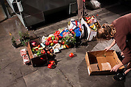 College students and freegans salvage food from a grocery store dumpster in San Diego, California. Freeganism is a movement based on limited participation in the conventional economy and minimal consumption of resources.