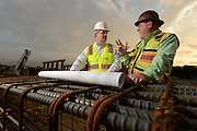 Construction workers on-site at a highway construction job in Fort Worth.