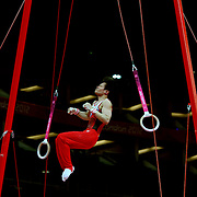 A Japanese gymnast performs of the rings during the Men's Artistic Gymnastics podium training at North Greenwich Arena during the London 2012 Olympic games preparation at the London Olympics. London, UK. 25th July 2012. Photo Tim Clayton