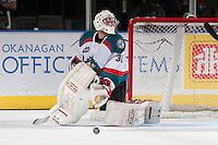 KELOWNA, CANADA - APRIL 25:  Jordon Cooke #30 of the Kelowna Rockets makes a save against the Portland Winterhawks on April 25, 2014 during Game 5 of the third round of WHL Playoffs at Prospera Place in Kelowna, British Columbia, Canada. The Portland Winterhawks won 7 - 3 and took the Western Conference Championship for the fourth year in a row earning them a place in the WHL final.  (Photo by Marissa Baecker/Getty Images)  *** Local Caption *** Jordon Cooke;
