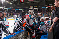KELOWNA, CANADA - APRIL 14: Referee Reagan Better stands at the boards and speaks to Kelowna Rockets' head coach Jason Smith against the Portland Winterhawks on April 14, 2017 at Prospera Place in Kelowna, British Columbia, Canada.  (Photo by Marissa Baecker/Shoot the Breeze)  *** Local Caption ***