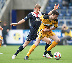 Falkirk's Stephen Kingsley and Dumbarton's Paul McGinn.<br /> Falkirk 1 v 2 Dumbarton, Scottish Championship game played today at the Falkirk Stadium.<br /> &copy;Michael Schofield.