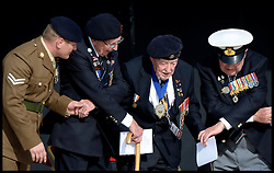 Image ©Licensed to i-Images Picture Agency. 06/06/2014. Arromanches, France, Veterans perform old auld lang syne as the The Duke and Duchess of Cambridge attend a Commemoration of the 70th anniversary of the Normandy Landings at Gold Beach, Normandy, France,  on the 70th anniversary of D-Day.  Picture by Andrew Parsons / i-Images