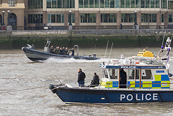 © Licensed to London News Pictures. 23/10/2018. London, UK. Metropolitan Marine Police watch on during a rehearsal for a display tomorrow when the Royal Marines and Royal Netherlands Marines will stage a joint on water capability demonstration with blank ammunition. As part of the Dutch state visit, King Willem-Alexander and Queen Máxima will attend the Dutch ship HNLMS Zeeland, which is anchored next to HMS Belfast. They will join The Duke of Kent on board and will be given a 10 minute display of the Royal Marines and Royal Netherlands Marines staging a joint on water capability demonstration.Photo credit: Vickie Flores/LNP