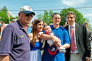 MAY 30, 2011 - Little Neck, New York, U.S. - New York Governor ANDREW CUOMO stops to talk with a young family with infant baby, while the Gov. is marching in Little Neck-Douglaston Memorial Day Parade, which honors American's veterans, on Northern Boulevard.