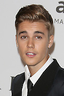 CAP D'ANTIBES, FRANCE - MAY 22:  Justin Bieber attends amfAR's 21st Cinema Against AIDS Gala, Presented By WORLDVIEW, BOLD FILMS, And BVLGARI at the 67th Annual Cannes Film Festival on May 22, 2014 in Cap d'Antibes, France.  (Photo by Tony Barson/FilmMagic)
