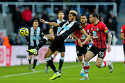 Joelinton (#9) of Newcastle United attempts to control the ball as it drops from a headed clearance during the Premier League match between Newcastle United and Southampton at St. James's Park, Newcastle, England on 8 December 2019.