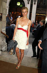 LAURA BAILEY at '4 Inches' a project 'For Women about Women By Women' - A photographic Auction in aid of the Elton John Aids Foundation hosted by Tamara Mellon President of Jimmy Choo and Arnaud Bamberger MD of Cartier UK at Christie's, 8 King Street, London W1 on 25th May 2005.<br /><br />NON EXCLUSIVE - WORLD RIGHTS