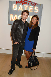 JAMES FRANCO and KATY WICKREMESINGHE at a private view of 'Psycho Nacirema' at Pace Gallery, 6-10 Lexington Street followed by a party at The Playboy Club, Old Park Lane, London on 5th June 2013.