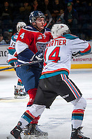 KELOWNA, CANADA -FEBRUARY 19: Matthew Gelinas #4 of the Tri City Americans checks Rourke Chartier #14 of the Kelowna Rockets on February 19, 2014 at Prospera Place in Kelowna, British Columbia, Canada.   (Photo by Marissa Baecker/Getty Images)  *** Local Caption *** Matthew Gelinas; Rourke Chartier;