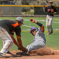 050215  Adron Gardner/Independent<br /> <br /> Gallup Bengal Bo Clark (15), left, tags out Miyamura Patriot Sean Silva (14) during a slide to third base at Ford Canyon Park in Gallup Saturday.