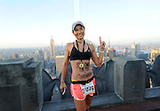 """Tricia O'Hara, 49, of France, the first female finisher, celebrates after completing the New York City - Southern New York Chapter of the National Multiple Sclerosis Society's """"Climb to the Top,"""" at Top of the Rock, Sunday, Feb. 28, 2016, in New York. (Photo by Diane Bondareff/AP Images for Tishman Speyer)"""