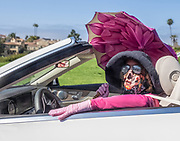 Woman Wearing Covid19 Fask Mask While Driving in Her Convertible