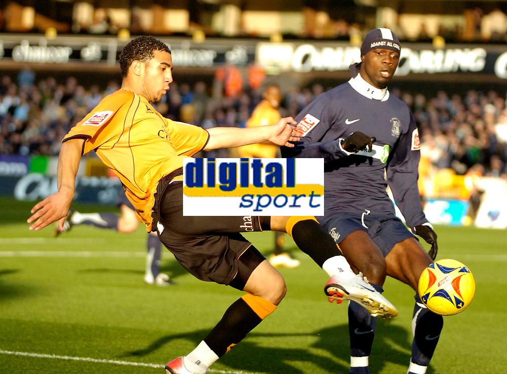 Photo: Ed Godden.<br /> Wolverhampton Wanderers v Southend United. Coca Cola Championship. 04/11/2006. Lewis Gobern (L), kicks the ball past Southend's Efetobore Sodje.