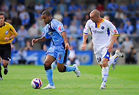 Photo: Leigh Quinnell.<br /> Wycombe Wanderers v Shrewsbury. Coca Cola League 2. 22/09/2007. Wycombes Jermaine Easter powers away from Shrewsburys Ben Hurd.