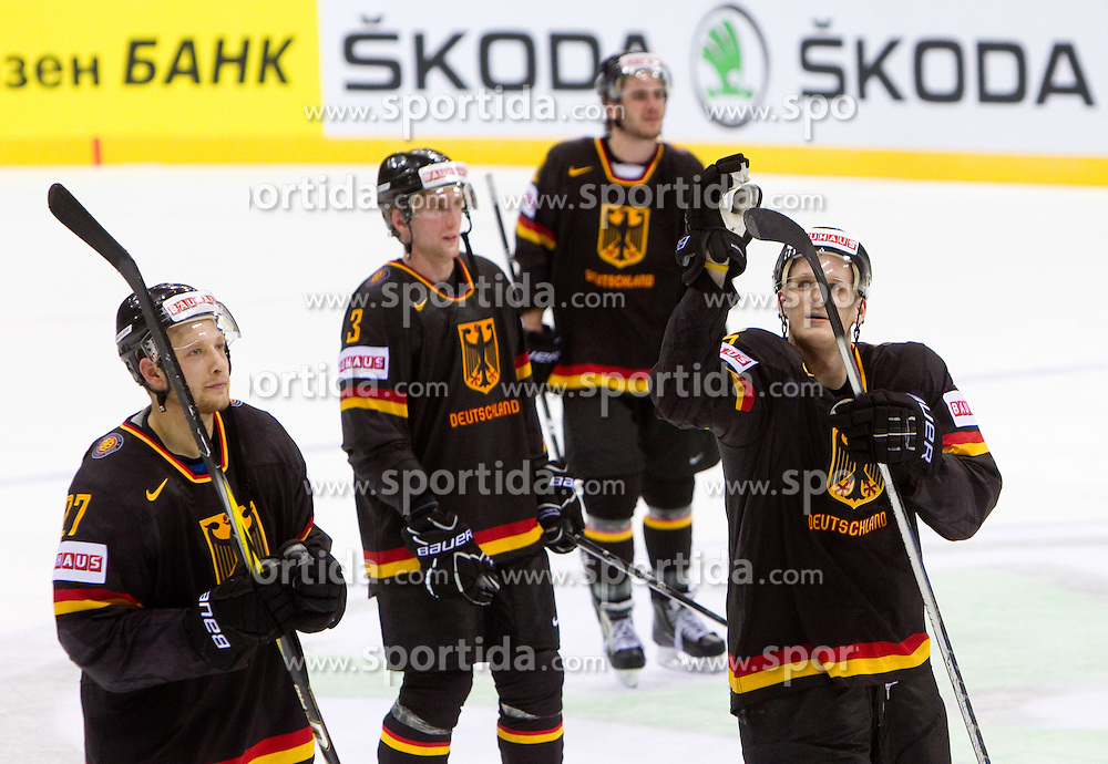 Kevin Lavallee, Justin Krueger and Korbinian Holzer of Germany celebrate after the ice-hockey match between Germany and Russia of Group A of IIHF 2011 World Championship Slovakia, on April 29, 2011 in Orange Arena, Bratislava, Slovakia. Germany defeated Russia 2-0. (Photo By Vid Ponikvar / Sportida.com)