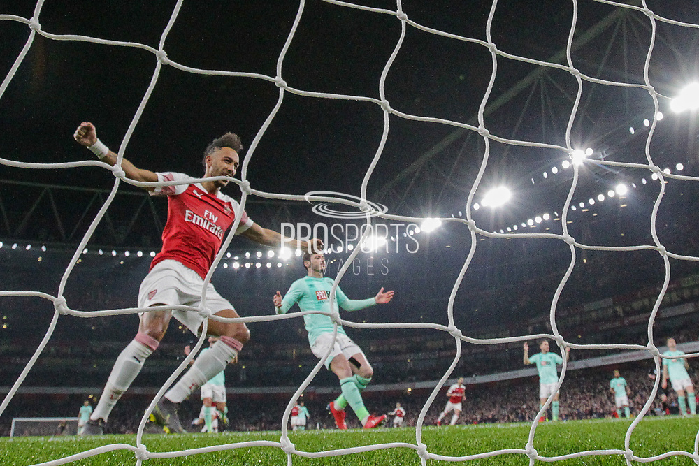 Arsenal forward Pierre-Emerick Aubameyang (14) celebrates after a goal (1-0) by Arsenal midfielder Mesut Ozil (10) (not in the photo) during the Premier League match between Arsenal and Bournemouth at the Emirates Stadium, London, England on 27 February 2019.