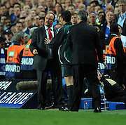 Rafael Benitez argues with Chelsea's Manager Guus Hiddink during the UEFA Champions League Quarter Final Second Leg match between Chelsea and Liverpool at Stamford Bridge on April 14, 2009 in London, England.